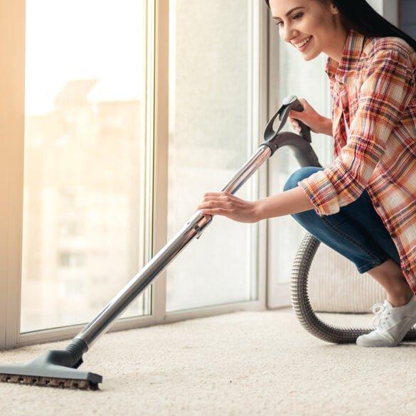 woman-clean-carpet-square | Haley's Flooring & Interiors