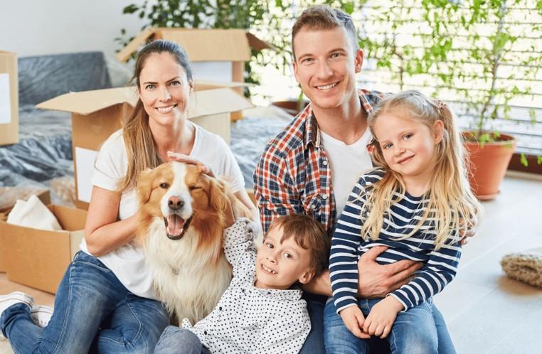 family-in-living-room | Haley's Flooring & Interiors