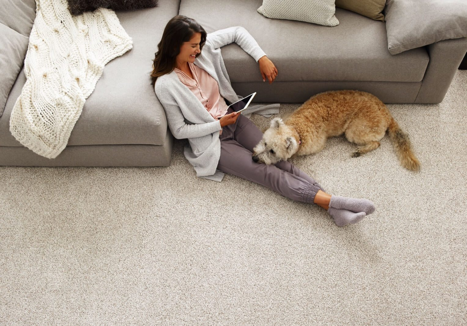 woman-on-carpet-with-dog | Haley's Flooring & Interiors